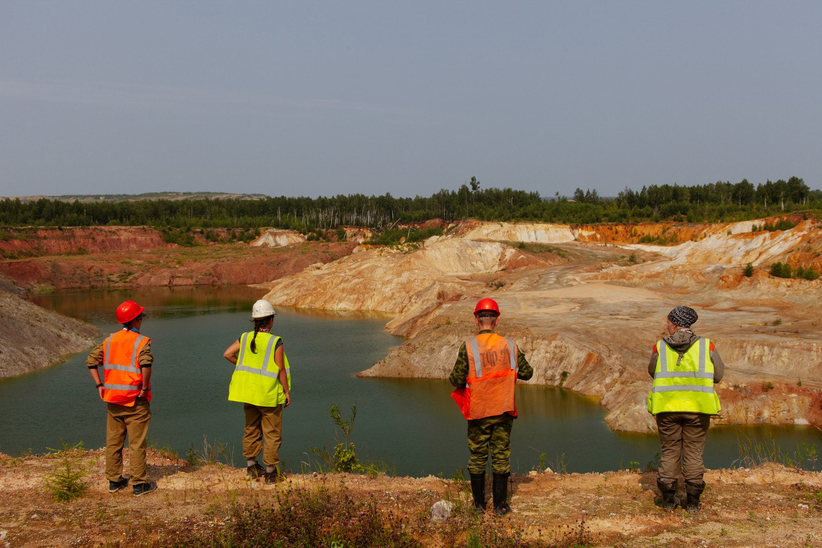 -workers-standing-near-lake