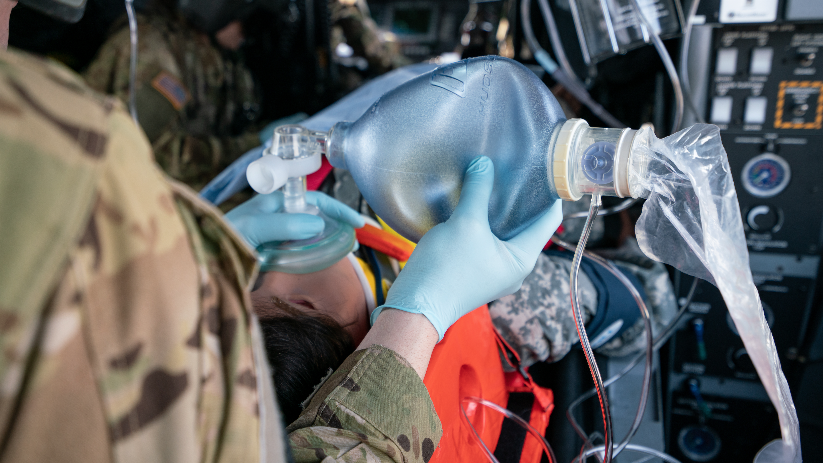 Soldier using Bag-Valve-Mask to ventilate a simulated trauma patient